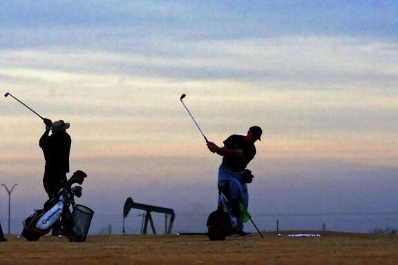 The oil and gas industry's impact on Midland is ubiquitous, even on this driving range. James Durbin/Reporter-Telegram