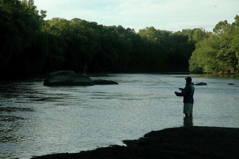 Texas' 15 major rivers and more than 3,700 named streams offer nearly unlimited opportunities for anglers. The Colorado River between Austin and La Grange, where this angler fishes around an island, holds outstanding largemouth and Guadalupe bass fishing. Photo: Shannon Tompkins / Houston Chronicle