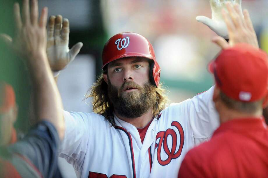 Washington's Jayson Werth is congratulated after scoring in the third inning against Houston. Photo: Mitchell Layton / Getty Images / 2014 Getty Images