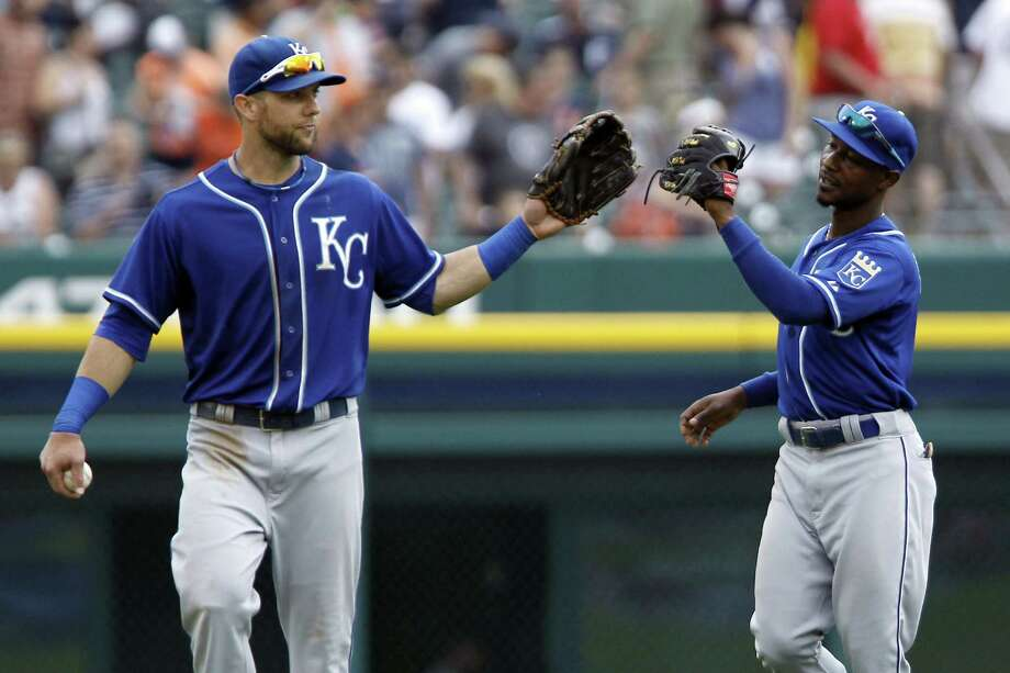 Alex Gordon (left) and Jarrod Dyson touch gloves after first-place Kansas City beat Detroit again. Photo: Duane Burleson / Getty Images / 2014 Getty Images