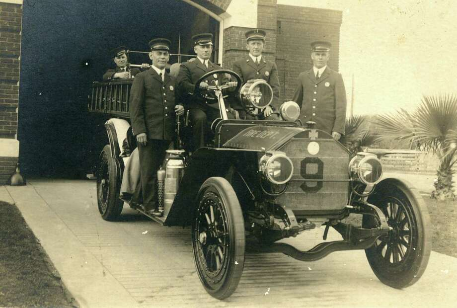 A fire crew stands at attention at Station 9 in 1913. Before the arrival of fire engines, horses were used to pull wagons. Photo: Photo Courtesy Of San Antonio Fire Museum