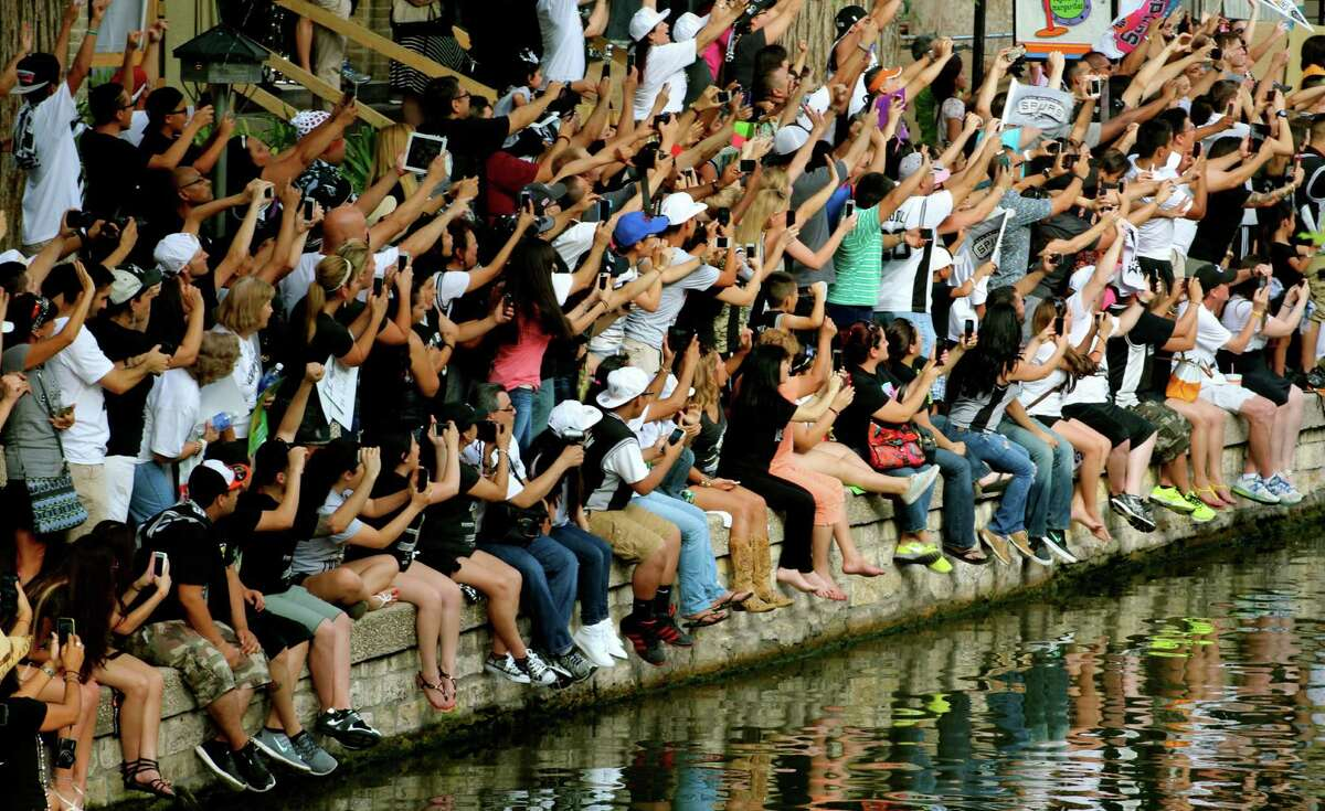 Spurs fans line the River Walk in 2014.