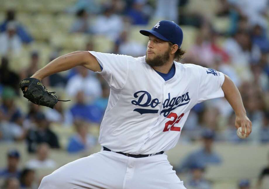 Los Angeles Dodgers starting pitcher Clayton Kershaw throws against the Colorado Rockies during first inning of a baseball game in Los Angeles, Wednesday, June 18, 2014. (AP Photo/Chris Carlson) Photo: Chris Carlson, Associated Press / AP