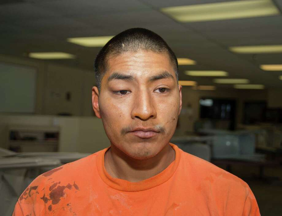 In this Thursday, Jan. 30, 2014 photo from the Arizona Department of Corrections, Jacob Harvey is shown shortly after he is accused of attacking a state prison teacher in Florence, Ariz.  Alone in a classroom for sex offenders at a state prison in Florence a state prison teacher was attacked by a convicted rapist who had been taking a test.  Harvey allegedly stabbed her with a pen, and raped her, then tried to use her radio to call for help when he had finished, according to reports released this week. Photo: Arizona Department Of Corrections, AP / Arizona Department of Corrections