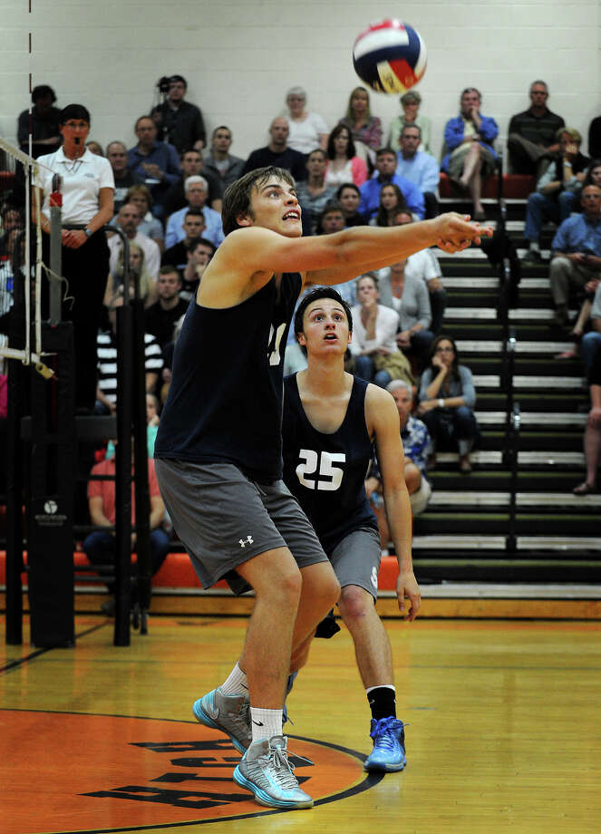 Staples' Lucas Grevers passes the ball as teammate Andrew Marriott looks on during the Wreckers' loss to Southington in the Class L state boys volleyball semifinals at Shelton High School in Shelton, Conn. on Monday, June 9, 2014. Photo: Brian A. Pounds / Connecticut Post