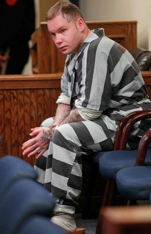 Inmate Donald Willburn Collins waits to be transported from the 359th State District Court Thursday, March 6, 2014 in Conroe after a ruling by Judge Kathleen Hamilton. The judge ruled that he will be tried as an adult for allegedly setting, 8-year-old Robert Middleton, on fire with gasoline in 1998. Robert died in 2011. Photo: Melissa Phillip, Houston Chronicle / © 2014  Houston Chronicle