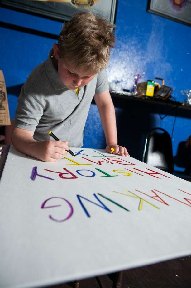 Mason James helps prepare decorations at the pride volunteer party at the Orleans St. Pub & Patio. Beaumont Pride is the city's first gay pride festival. Photo: Lacie Grant/cat5