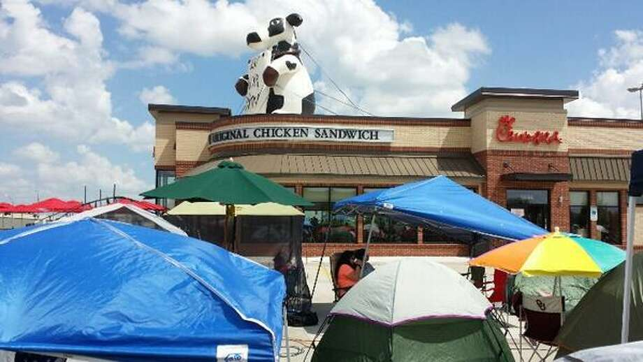 """New Chick-Fil-A store openings are kind of a big deal in Texas. About 130 fans showed up Wednesday, June 18, 2014 at a new store in Richmond, Texas hoping to be a part of the """"First 100"""" party. Chick-fil-A fans whose numbers were drawn for the First 100 got the privilege of camping out throughout the day Wednesday and overnight in order to be the first to eat at the new restaurant and win free food for a year. The group was treated to free food throughout their stay and games like the water balloon toss and trick-shot Oreo eating. Photo: Michael McKinney On Twitter (@MrMcHemistry) 