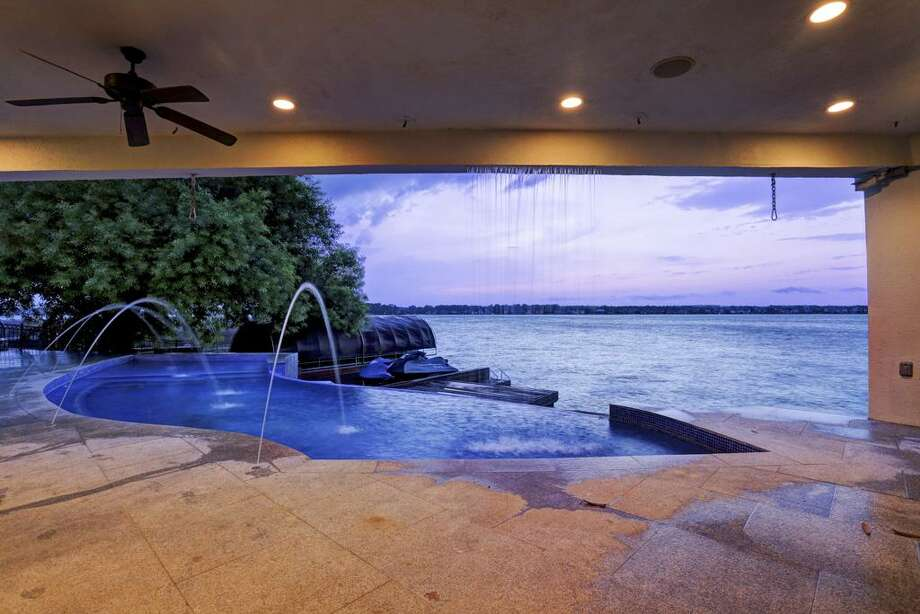This modern waterfront home is a work of art. Photo: Houston Association Of Realtors