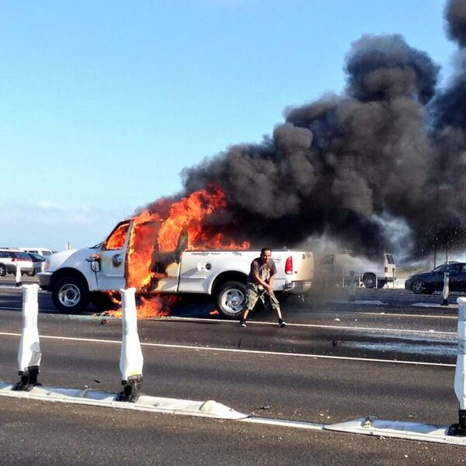 A man stands in front of a burning truck Thursday morning on the Bay Bridge. Photo: Courtesy Kevin Wilson