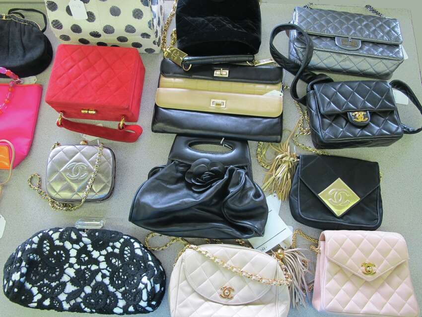 Handbags owned by Michael and Linda Mastro, pictured in a photo provided by auction house James G. Murphy Co. A collection of the couple's belongings are slated for auction Thursday, June 26, at the firm's Kenmore site.
