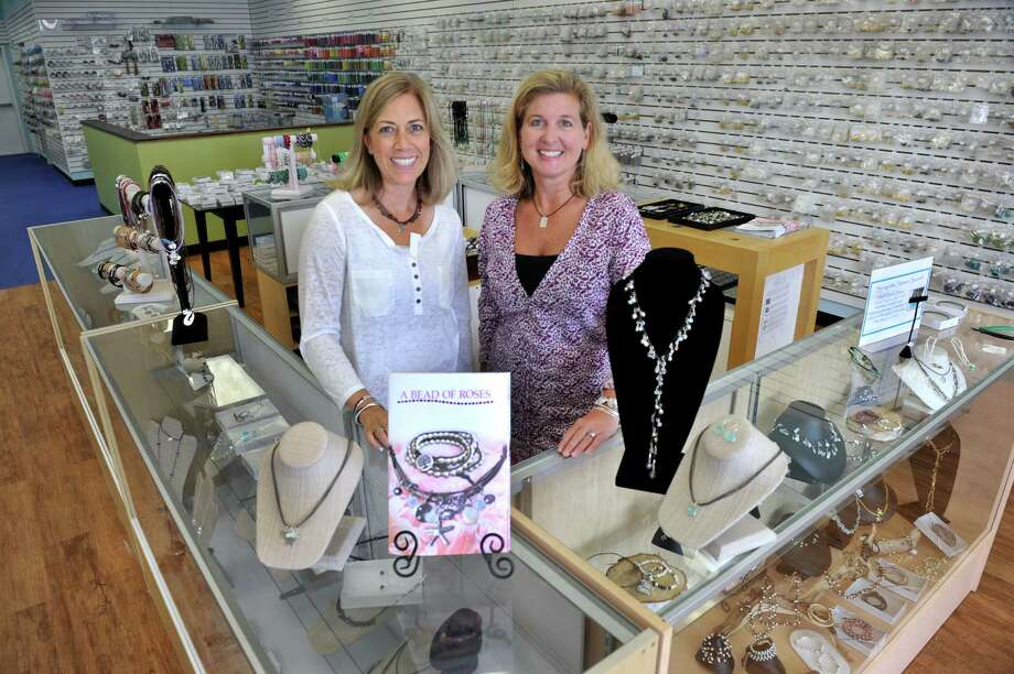 Traci A. Gentry, left, and Lisa M. Rose, managing partners in A Bead of Roses in Newtown, Conn., are photographed in their recently expanded space Thursday, June 19, 2014. Photo: Carol Kaliff / The News-Times