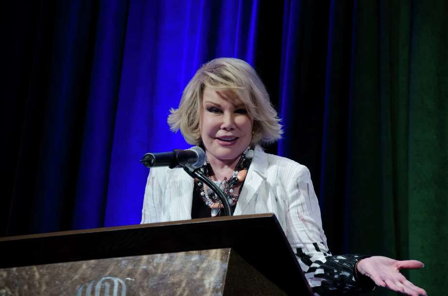 Joan Rivers speaks during the Impact Awards Luncheon at the Royal Sonesta hotel. Photo: Rena Iglehart / Rena Iglehart