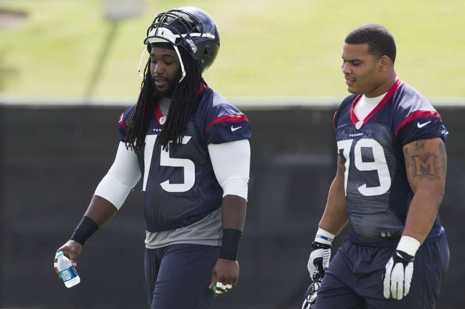 Texans offensive linemen Derek Newton (75) and Brandon Brooks (79) walk across the practice field. Photo: Brett Coomer, Houston Chronicle