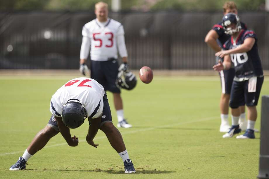 Texans defensive end Julius Warmsley (74) works on his long snaps. Photo: Brett Coomer, Houston Chronicle