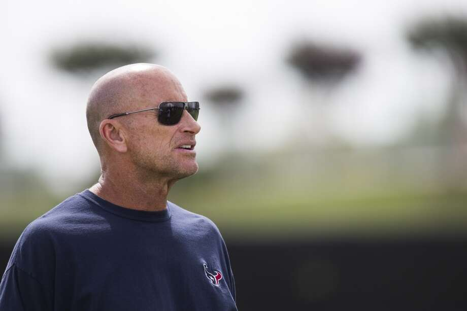 Texans defensive line coach Bill Kollar stands on the practice field. Photo: Brett Coomer, Houston Chronicle