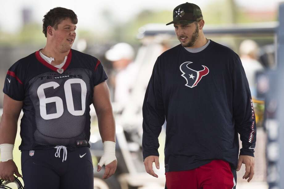 Texans guard Ben Jones (60) talks to tackle David Quessenberry. Photo: Brett Coomer, Houston Chronicle