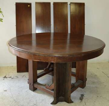 Sharon Bush, the former wife of Neil Bush, is auctioning off a handful of pieces of furniture that the Bush family used during family functions here in Houston. Included is an antique oak table that Bush says was popular with Bush 41.