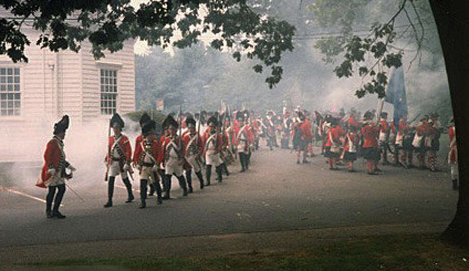 The British, led by General William Tryon, marched across Fairfield's beaches toward the town's meeting house green where they burned 97  houses and other buildings. The burning of Fairfield was re-enacted in 1989. Courtesy: Fairfield Museum and History Center Photo: Contributed Photo / Fairfield Citizen