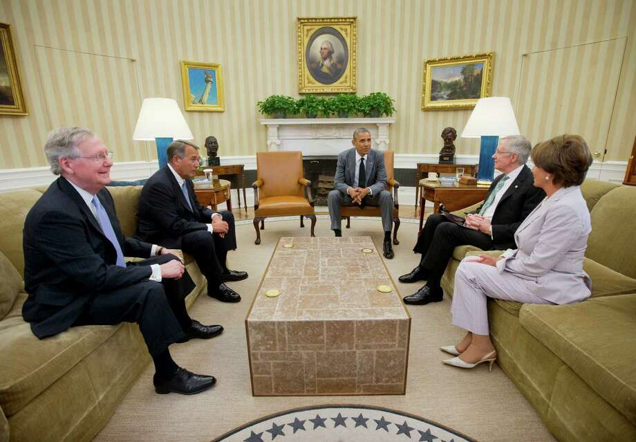 President Barack Obama meets with, from left, Senate Minority Leader Mitch McConnell of Ky., House Speaker John Boehner of Ohio, Senate Majority Leader Harry Reid of Nev., and House Minority Leader Nancy Pelosi of Calif., in the Oval Office of the White House in Washington, Wednesday, June 18, 2014. Obama briefed leaders of Congress on US options for blunting an Islamic insurgency in Iraq. US officials say Obama is not yet prepared to move forward with strikes and is instead focused on increased training for Iraq's security forces, boosting Iraqi intelligence capacities and upgrading equipment. Photo: Pablo Martinez Monsivais, AP / AP