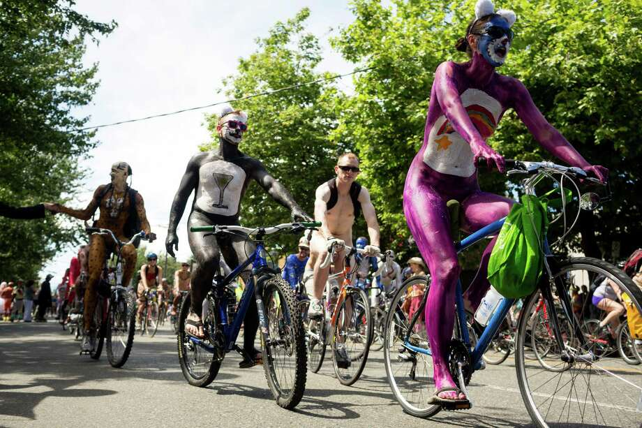 We in Seattle know that with the Summer Solstice comes a horde of naked bicyclists peddling through Fremont.This year's parade - which includes many spectacular sights other than people's painted privates - starts at 3 p.m. Saturday and rolls through the heart of Fremont and into Gasworks Park.Now if you haven't done it before but are considering jointing the circus, there's some strategy and etiquette involved in being a birthday suit biker. Because we care, we're passing along advice from seasoned naked cyclists so that you can naked bike like a pro. Oh, and there are a few tips for spectators, too.The entire Fremont Fair runs Friday through Sunday. Photo: JORDAN STEAD, Seattlepi.com File Photo / SEATTLEPI.COM
