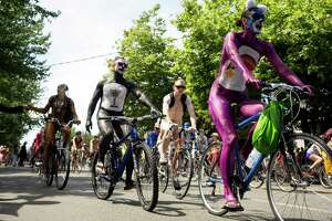 Naked bicyclists take to the streets during the 25th anniversary of the Fremont Solstice Parade Saturday, June 22, 2013, in the Fremont neighborhood of Seattle. The parade, which is usually held at noon, was pushed to 3 p.m. this year. (Jordan Stead, seattlepi.com)
