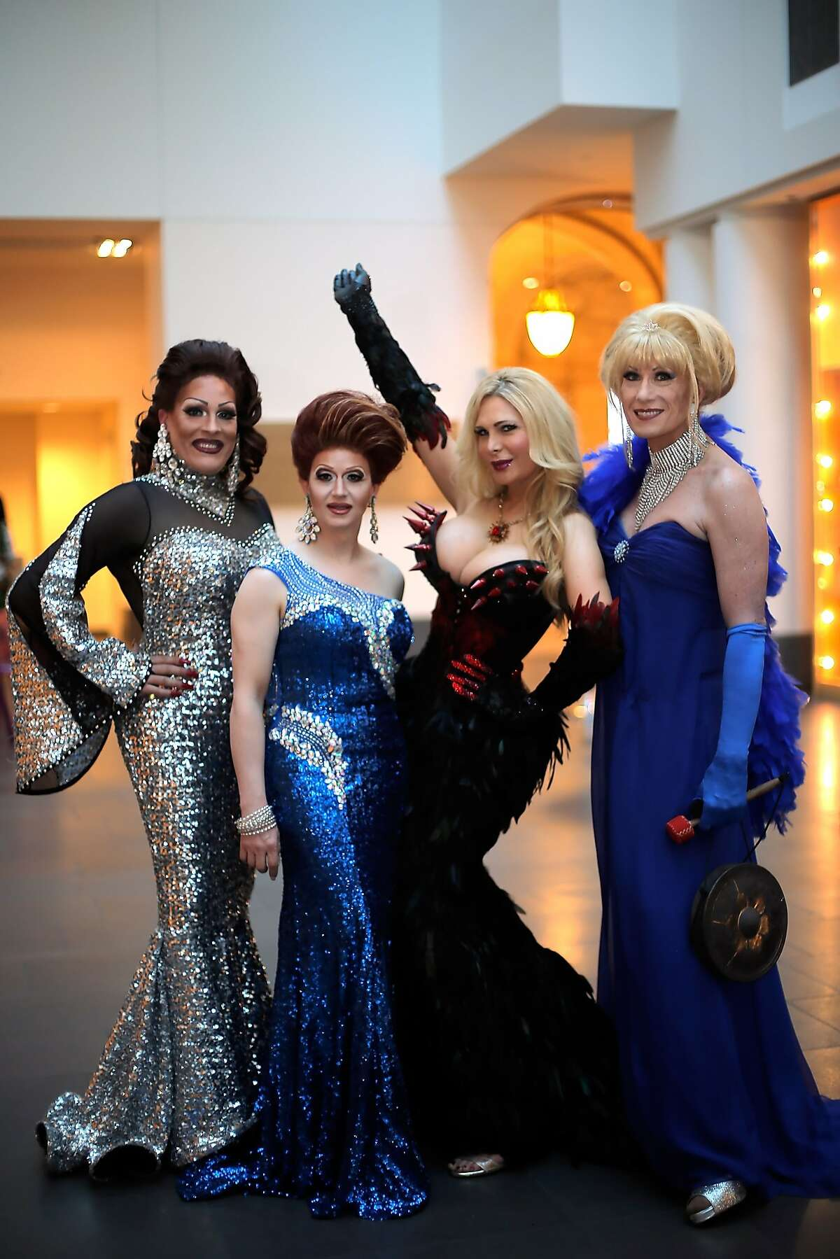 Draq queens (l-r) Kendra Monroe, Holotta Time, Cassandra Cass, and Donna Sachet pose for a photo at a gala dinner party for the new exhibit,