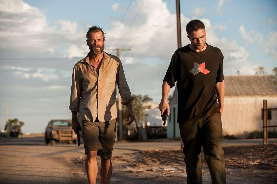 Guy Pearce and Robert Pattinson in The Rover Photo: Matt Nettheim, A24