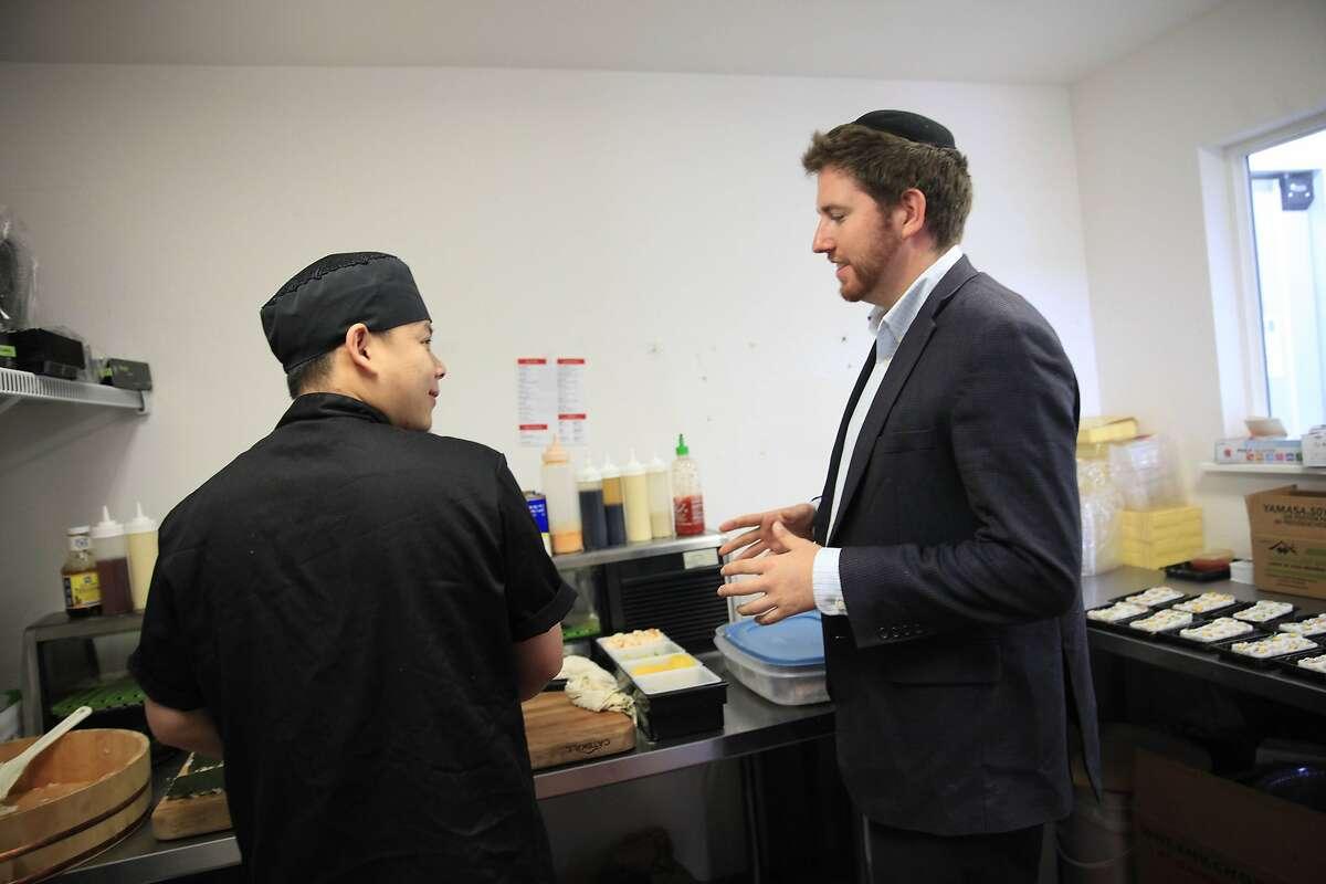 Head sushi chef Jagun Nkaukawng, left, talks to founder Rabbi Alex Shandrovsky.