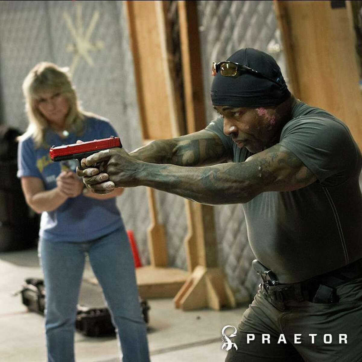 King County Sheriff's Deputy Darrion Holiwell is shown in a publicity photo for his firearms equipment and training business, Praetor Defense. He was arrested Thursday morning for investigation of promoting prostitution.