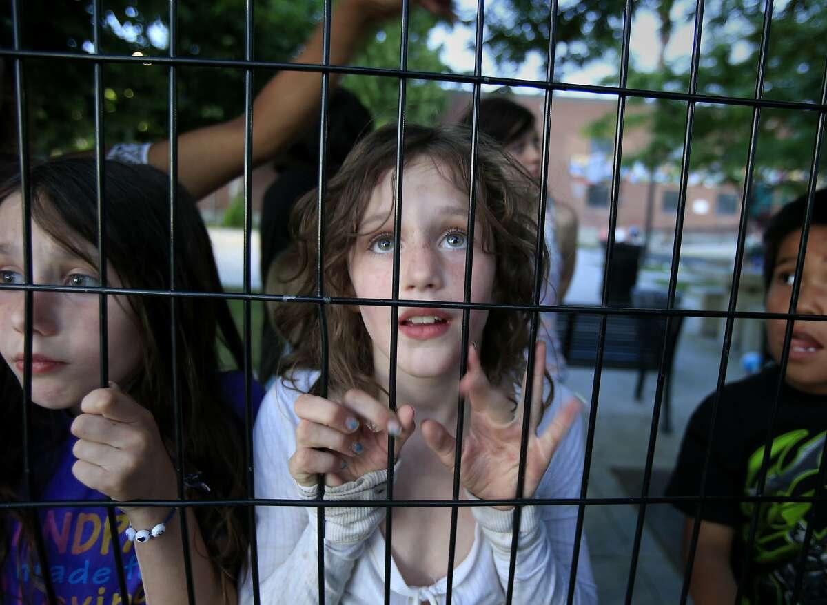 Homeless children, including Alexandra (center), at