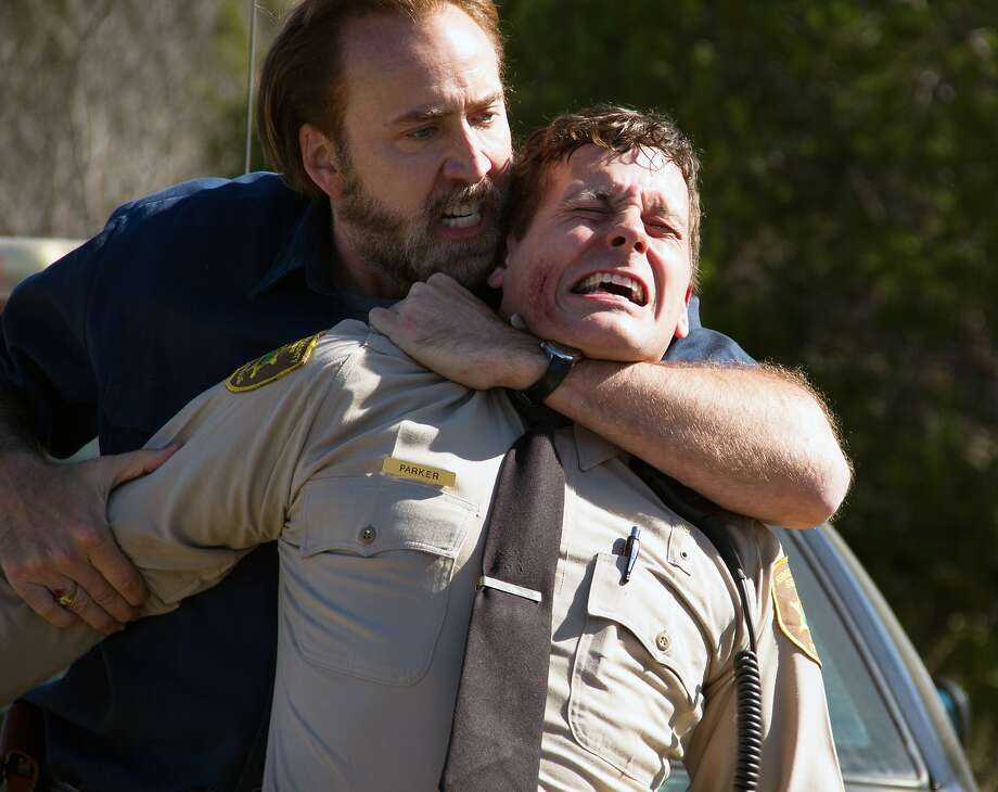 "Nicolas Cage (left) and Jonny Mars in ""Joe."" Photo: Linda Kallerus, Associated Press"