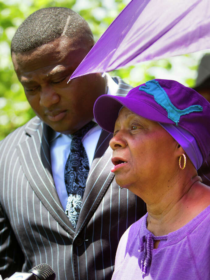 Quanell X  stands with Ethel Nelloms, a Bradshaw descendant, at a press conference at a historic African American cemetery, Thursday, June 19, 2014, in Houston. The family wants to halt the desecration of the cemetery dating back to the 1800s. A developer claimed ownership as they began to excavate the property. Photo: Cody Duty, Houston Chronicle / © 2014 Houston Chronicle