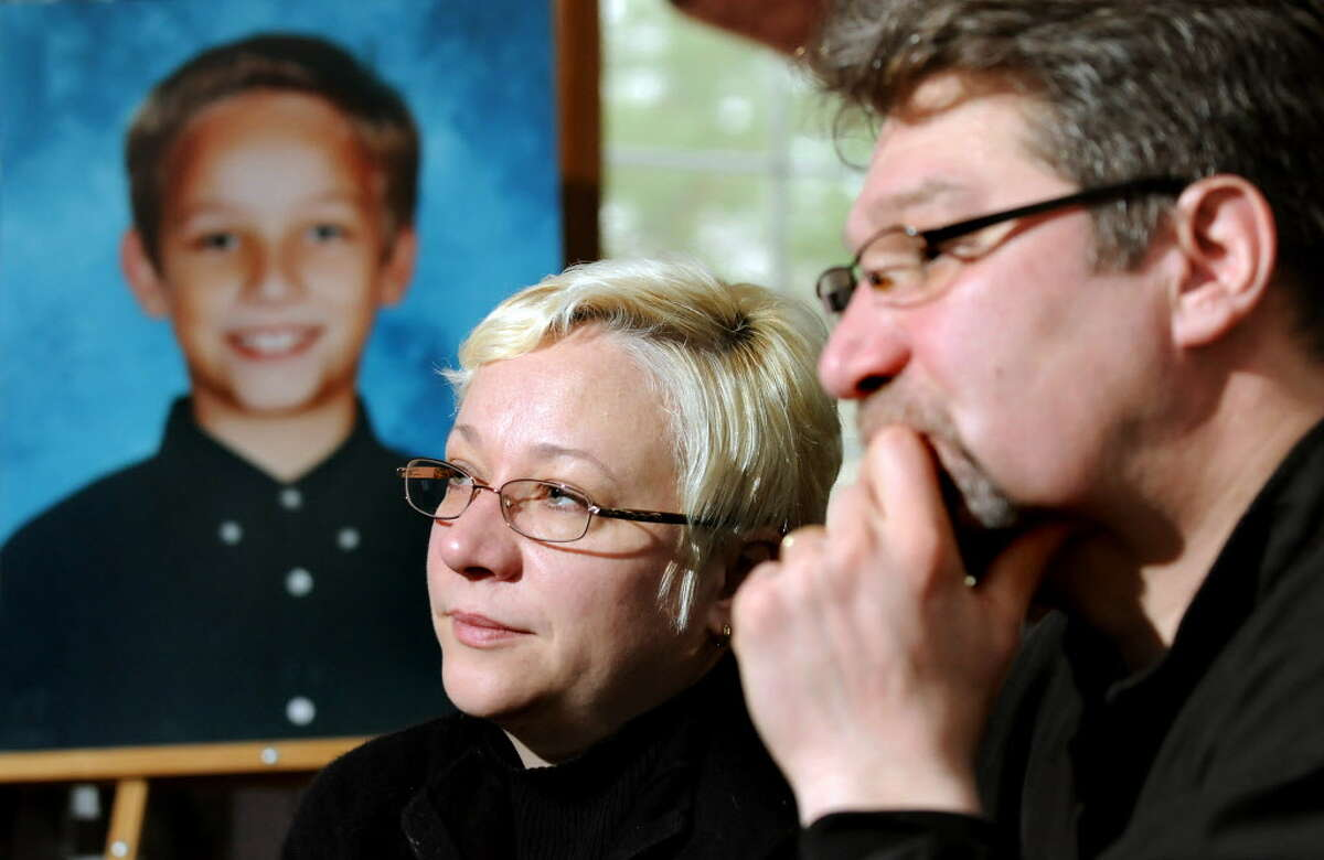 In this 2011 archive photo, Oksana and Yuri Naumkin talk about Nicholas, their son who was killed on Dec. 22, 2010, after a friend shot him accidentally. (Cindy Schultz / Times Union archive)