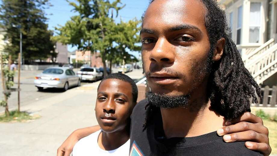 "Joshua Clayton, 22, and his cousin Dajon Jones, 13, grew up in West Oakland. Clayton created ""There Are No Children in Oakland."" See it here:  http://bit.ly/1yqDbXy. Photo: Brett Myers, Youthradio"