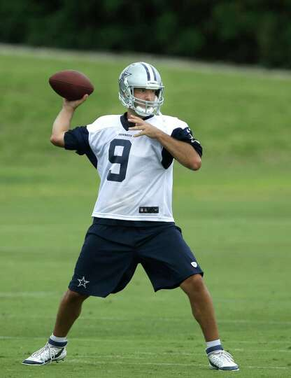 Dallas Cowboys quarterback Tony Romo passes during an NFL football minicamp, Wednesday, June 18, 201