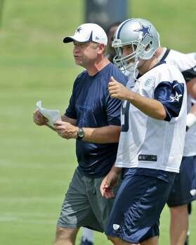 2388 x 3000~~$~~Dallas Cowboys offensive coordinator Scott Linehan, left, talks to quarterback Tony Romo (9) during an NFL football minicamp Wednesday, June 18, 2014, in Irving, Texas. Photo: LM Otero, AP / AP