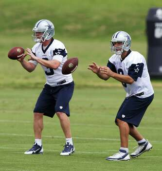 Dallas Cowboys quarterbacks Tony Romo, right, and Brandon Weeden (3) take a snap during an NFL football minicamp, Wednesday, June 18, 2014, in Irving, Texas. (AP Photo/LM Otero) Photo: LM Otero, Associated Press / AP