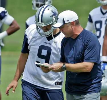 Dallas Cowboys quarterback Tony Romo (9) listens to offensive coordinator Scott Linehan during an NFL football minicamp Wednesday, June 18, 2014, in Irving, Texas. (AP Photo/LM Otero) Photo: LM Otero, Associated Press / AP