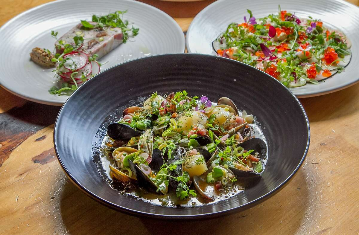 The Clams and Mussels with the Rabbit Terrine, back left, and the Fisherman's Cheese, back right, at The Coachman in San Francisco, Calif., are seen on Saturday, June 14th, 2014.