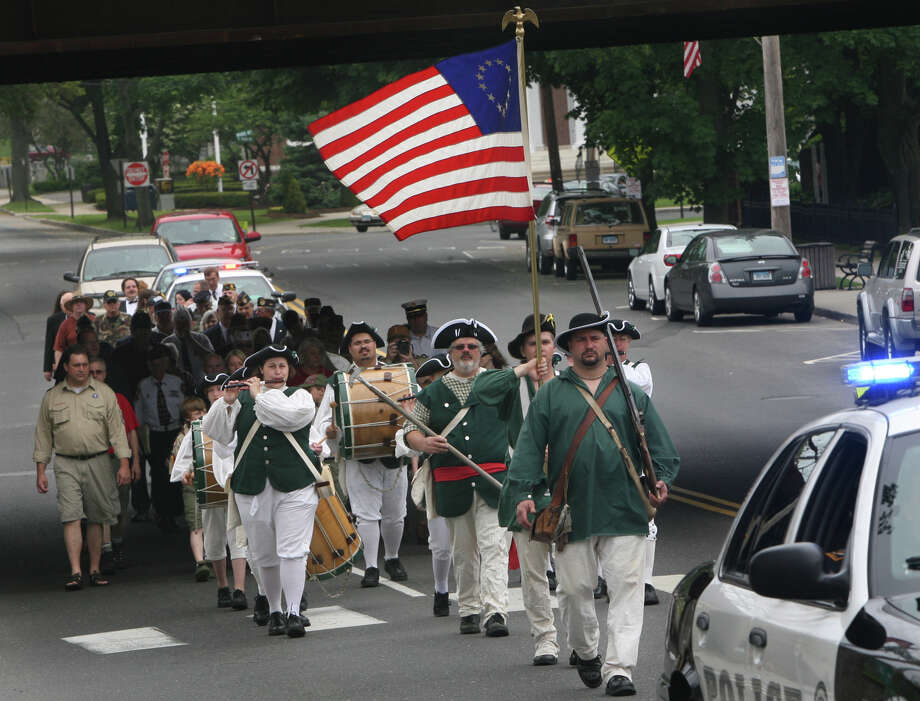 Milford Volunteers Ancient Fife and Drum Corps march during the Milford wreath laying ceremony in 2011. The group will host a muster, a gathering of similar musical groups, on Saturday, June 28, 2014. Photo: B.K. Angeletti/File Photo, ST / Connecticut Post