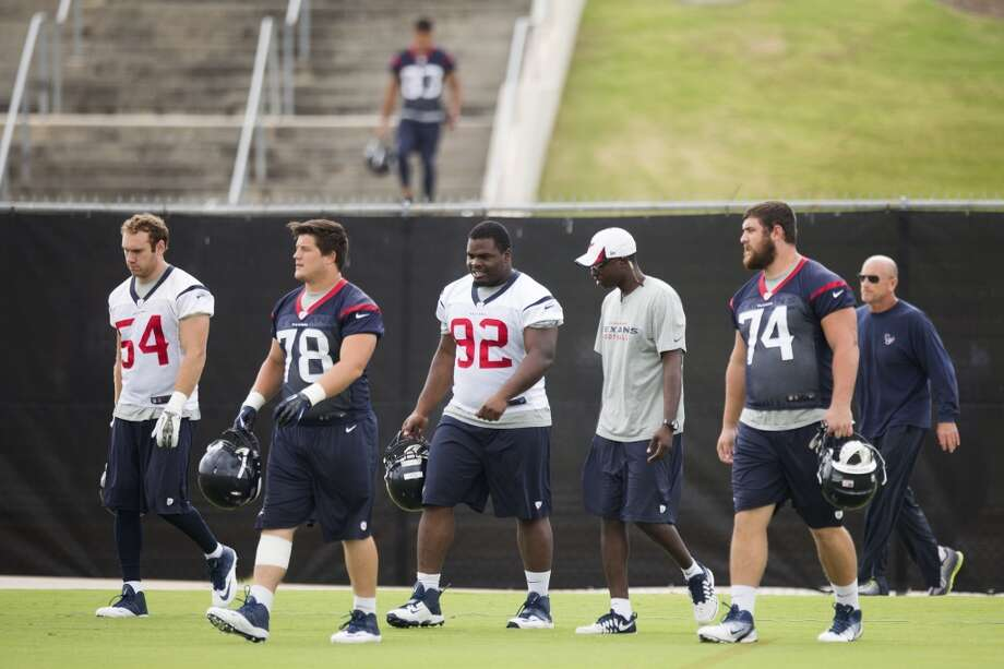 Mike Mohamed (54), James Ferentz (78), Louis Nix III (92) and Matt Feiler (74) walk across the practice field. Photo: Brett Coomer, Houston Chronicle