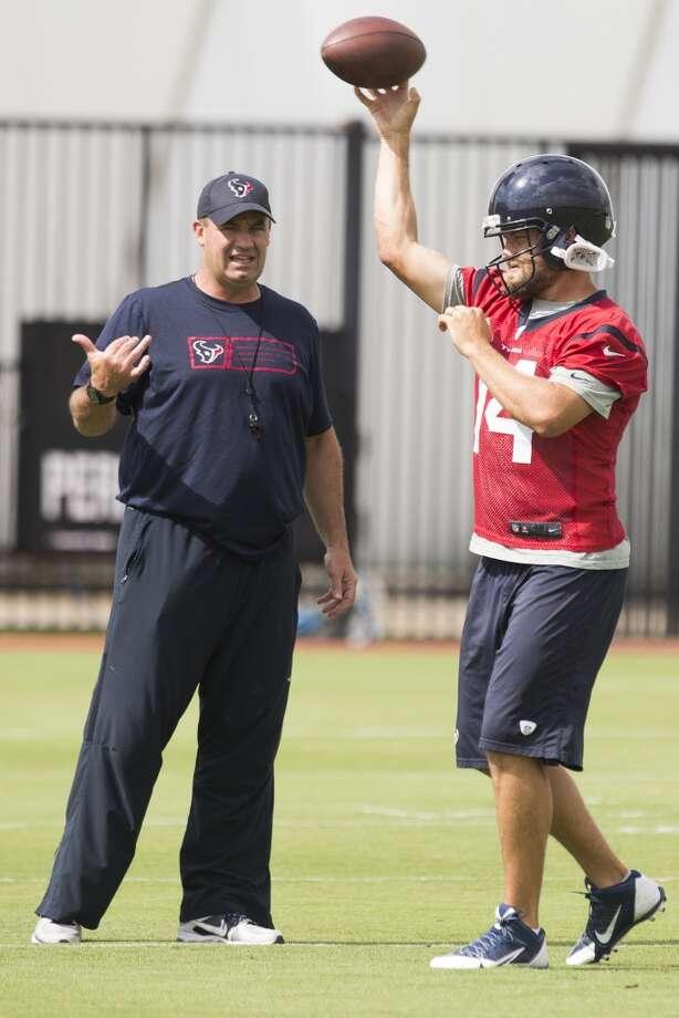 Texans head coach Bill O'Brien, left, talks to quarterback Ryan Fitzpatrick (14). Photo: Brett Coomer, Houston Chronicle