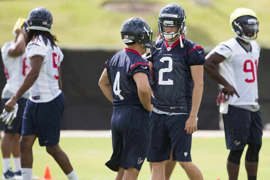Texans kicker Chris Boswell (2) talks to fellow kicker Randy Bullock (4). Photo: Brett Coomer, Houston Chronicle