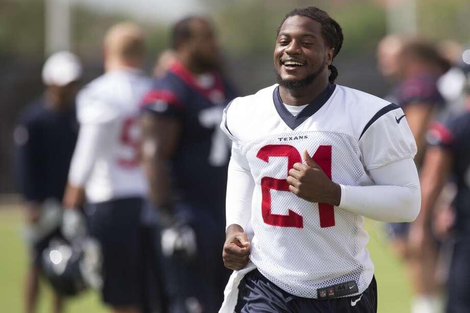 Texans safety Kendrick Lewis jogs across the field. Photo: Brett Coomer, Houston Chronicle