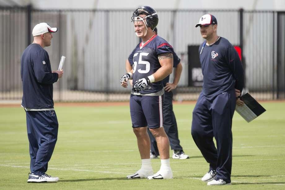 Texans center Chris Myers (55) talks to quarterbacks coach George Godsey. Photo: Brett Coomer, Houston Chronicle