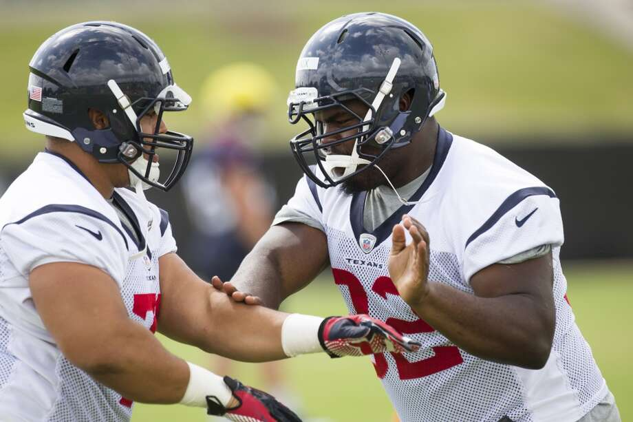 Texans nose tackles Austin Brown, left, and Louis Nix III (92) work out. Photo: Brett Coomer, Houston Chronicle