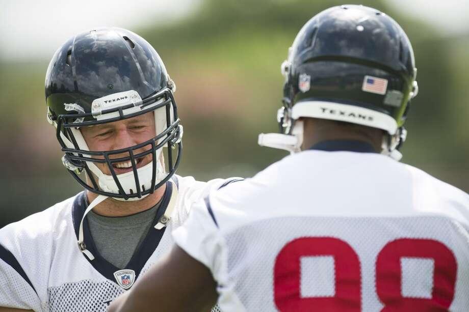 Texans defensive linemen J.J. Watt, left, and Tim Jamison work out. Photo: Brett Coomer, Houston Chronicle