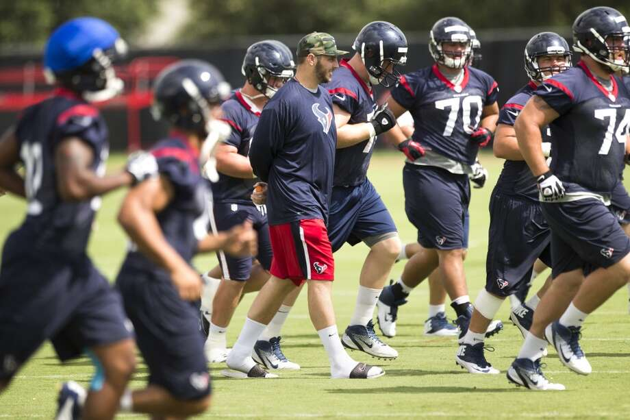 Texans tackle David Quessenberry walks across the field with his teammates. Photo: Brett Coomer, Houston Chronicle