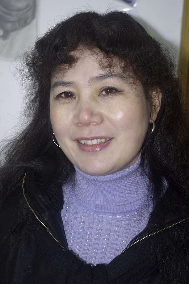 In this Jan. 1, 2010 photo taken and released by Liao Minyue, daughter of Chinese activist Liu Ping, Liu poses for a photo in Xinyu city in eastern China's Jiangxi province. A court in eastern China has imposed jail terms of up to six and a half years to three activists who were part of a nascent civil rights movement that has urged government officials to publicly disclose their assets. Attorney Zhou Ze says a district court in the city of Xinyu on Thursday, June 19, 2014 sentenced activists Liu Ping and Wei Zhongping to six and a half years' imprisonment each while another activist, Li Sihua, was handed three years. (AP Photo/Liao Minyue) Photo: Liao Minyue, Associated Press